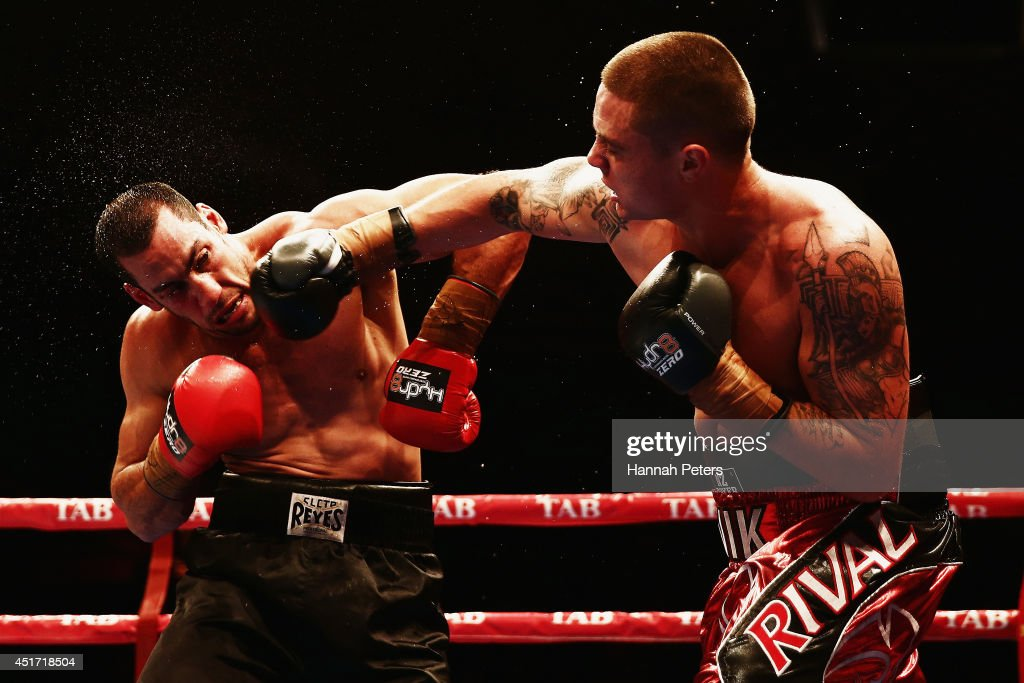 Nik Charalampous of New Zealand fights Aaron Lai of Australia during fight two at Vodafone Events Centre on July 5, 2014 in Auckland, New Zealand.