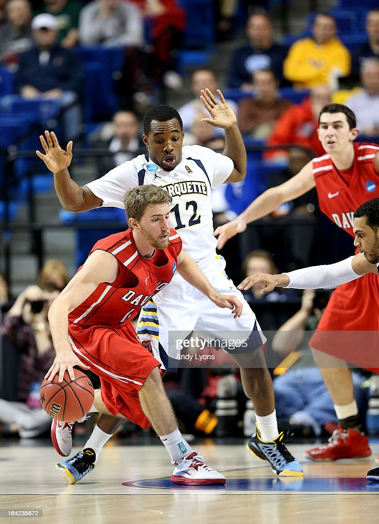 Nik Cochran #12 of the Davidson Wildcats drives against Derrick Wilson #12 of the Marquette Golden Eagles in the second half during the second round of the 2013 NCAA Men's Basketball Tournament at the Rupp Arena on March 21, 2013 in Lexington, Kentucky.