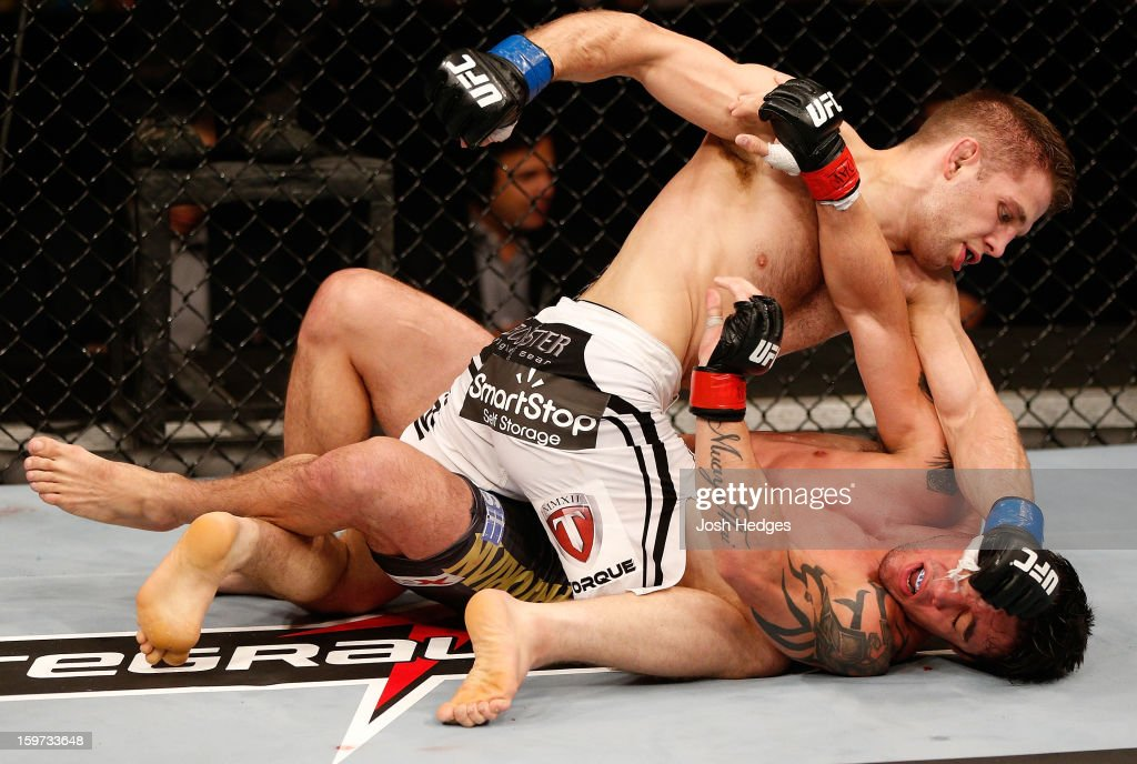 Nik Lentz (white shorts) punches Diego Nunes in their featherweight fight at the UFC on FX event on January 19, 2013 at Ibirapuera Gymnasium in Sao Paulo, Brazil.