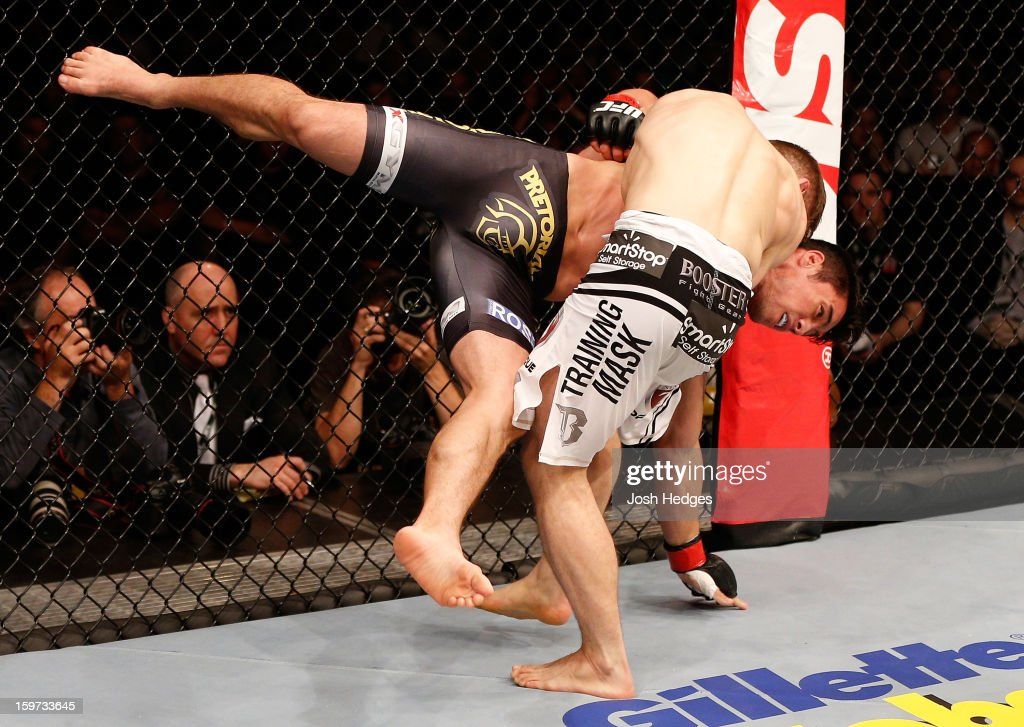 Nik Lentz (white shorts) takes down Diego Nunes in their featherweight fight at the UFC on FX event on January 19, 2013 at Ibirapuera Gymnasium in Sao Paulo, Brazil.