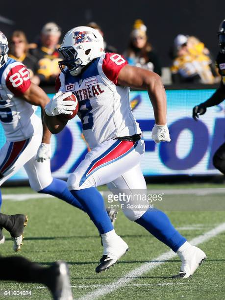 Nik Lewis of the Montreal Alouettes gains yards after a pass reception against the Hamilton TigerCats during a CFL game at Tim Hortons Field on...