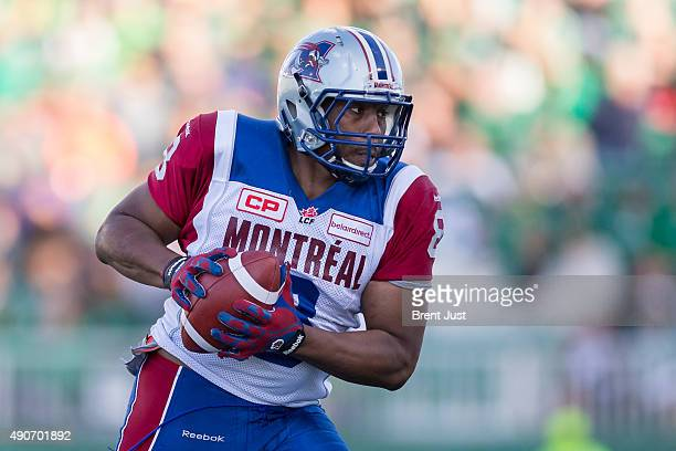 Nik Lewis of the Montreal Alouettes looks to run after a catch in the game between the Montreal Alouettes and Saskatchewan Roughriders in week 14 of...