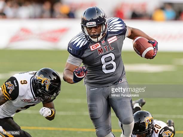 Nik Lewis of the Montreal Alouettes runs with the ball during the CFL game against the Hamilton TigerCats at Percival Molson Stadium on July 16 2015...