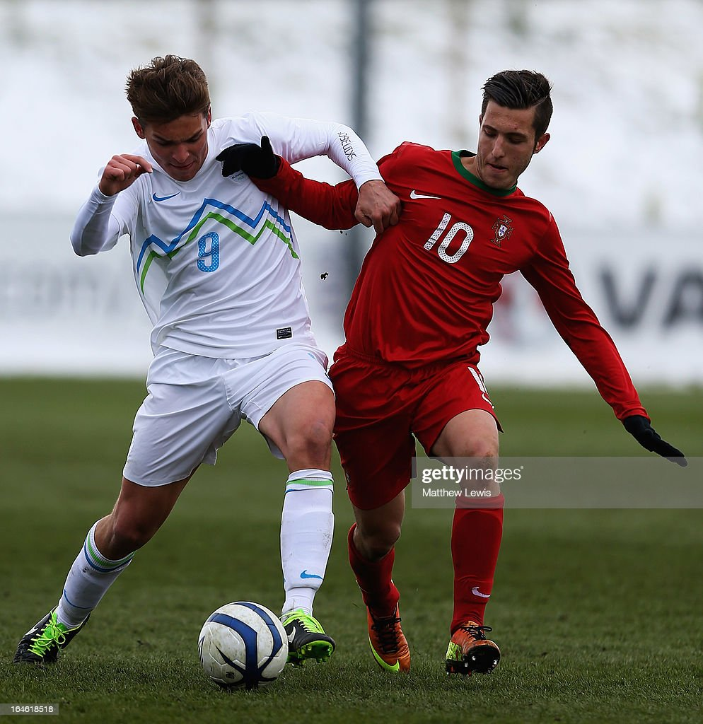 Nik Lorbek of Slovenia and Rui Moreira of Portugal challenge for the ball during the UEFA European Under-17 Championship Elite Round match between Slovenia and Portugal at St George's Park on March 25, 2013 in Burton-upon-Trent, England.