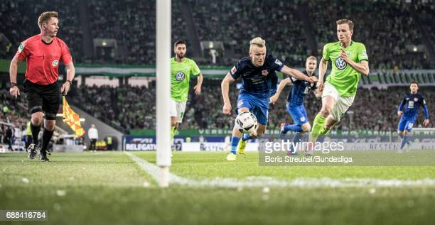 Nik Omladic of Eintracht Brauschweig battles for the ball with Yannick Gerhardt of VfL Wolfsburg during the Bundesliga Playoff Leg 1 match between...