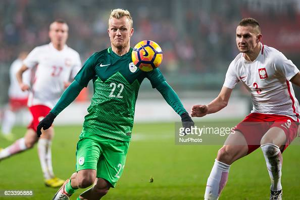 Nik Omladic of Slovenia vies Artur Jedrzejczyk of Poland during the international friendly football match Poland vs Slovenia on November 14 2016 in...