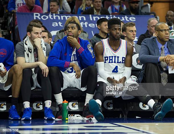 Nik Stauskas Hollis Thompson and Nerlens Noel of the Philadelphia 76ers look on from the bench during the game against the Los Angeles Lakers on...