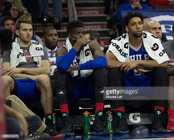 Nik Stauskas Nerlens Noel and Jahlil Okafor of the Philadelphia 76ers watch the final minutes of the game against the Utah Jazz from the bench on...