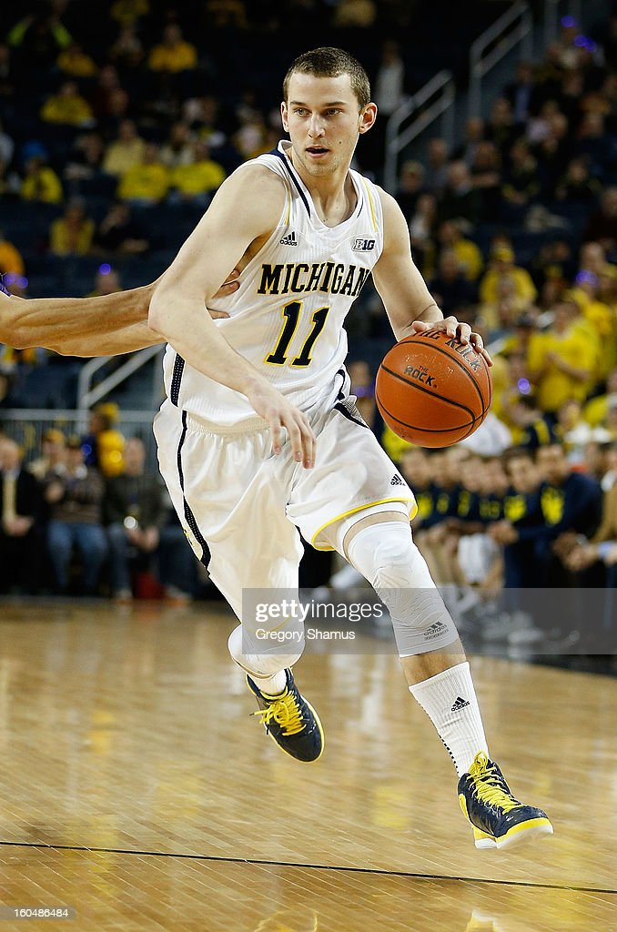 Nik Stauskas #11 of the Michigan Wolverines dribbles against the Northwestern Wildcats at Crisler Center on January 30, 2013 in Ann Arbor, Michigan.