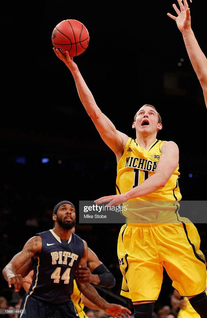 Nik Stauskas #11 of the Michigan Wolverines drives the ball towards the net against the Pittsburgh Panthers during the NIT Season Tip-Off at Madison Square Garden on November 21, 2012 in New York City. Michigan defeated Pittsburgh 67-62.