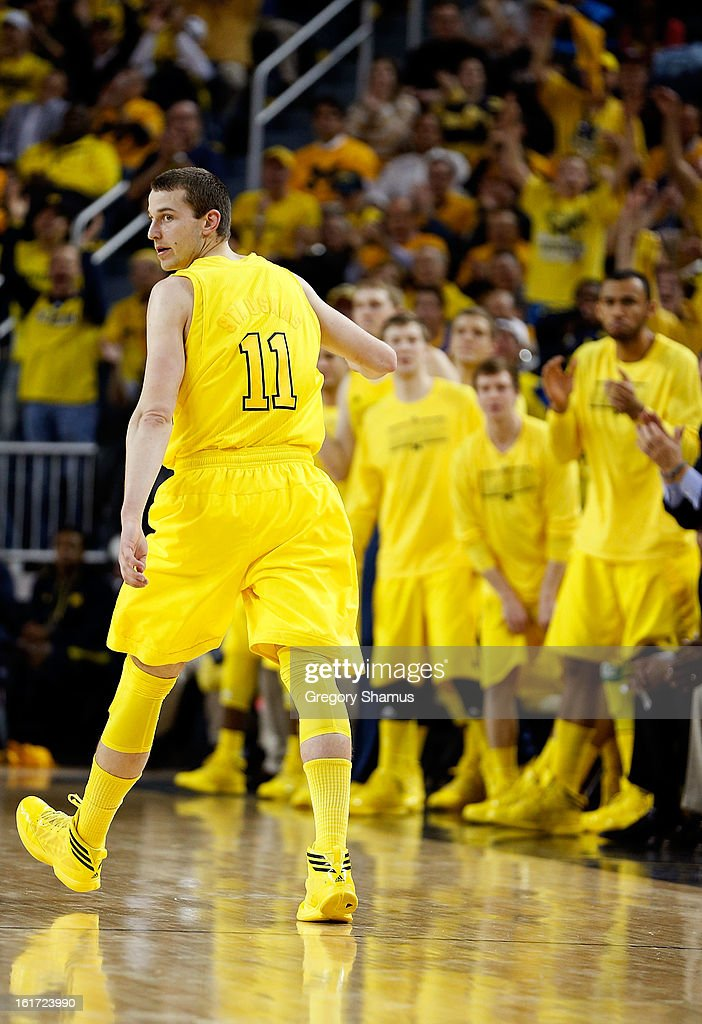 Nik Stauskas #11 of the Michigan Wolverines heads down court against the Ohio State Buckeyes at Crisler Center on February 5, 2013 in Ann Arbor, Michigan. Michigan won the game 76-74 in overtime.