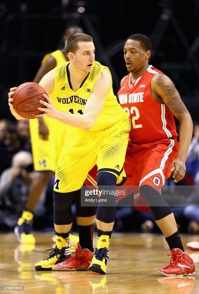 <a gi-track='captionPersonalityLinkClicked' href=/galleries/search?phrase=Nik+Stauskas&family=editorial&specificpeople=9920522 ng-click='$event.stopPropagation()'>Nik Stauskas</a> #11 of the Michigan Wolverines is defended by Lenzelle Smith Jr. #32 of the Ohio State Buckeyes during the second half of the Big Ten Basketball Tournament Semifinal game at Bankers Life Fieldhouse on March 15, 2014 in Indianapolis, Indiana. Michigan defeated Ohio State 72-69.