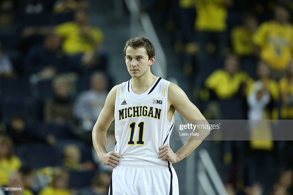 Nik Stauskas #11 of the Michigan Wolverines looks on during the second half of the game against Wayne State University at Crisler Center on November 4, 2013 in Ann Arbor, Michigan. Michigan defeated Wayne State 79-60.