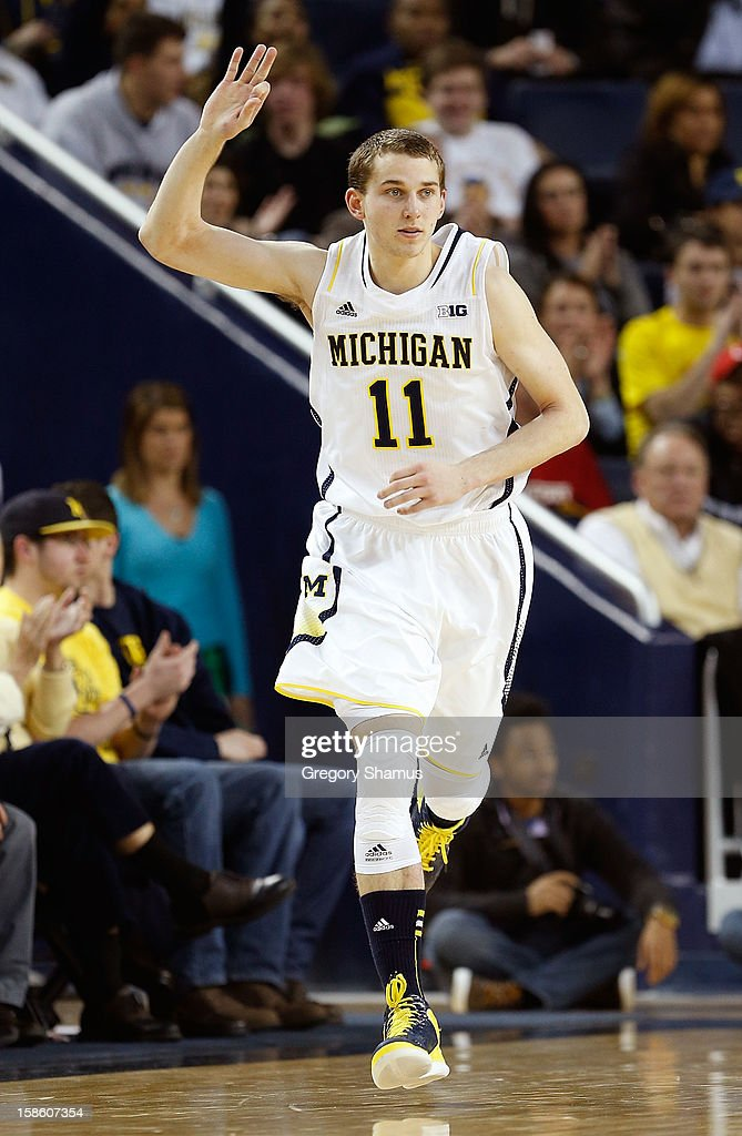 Nik Stauskas #11 of the Michigan Wolverines reacts after hitting a second half three point basket while playing the Eastern Michigan Eagles at Crisler Center on December 20, 2012 in Ann Arbor, Michigan.