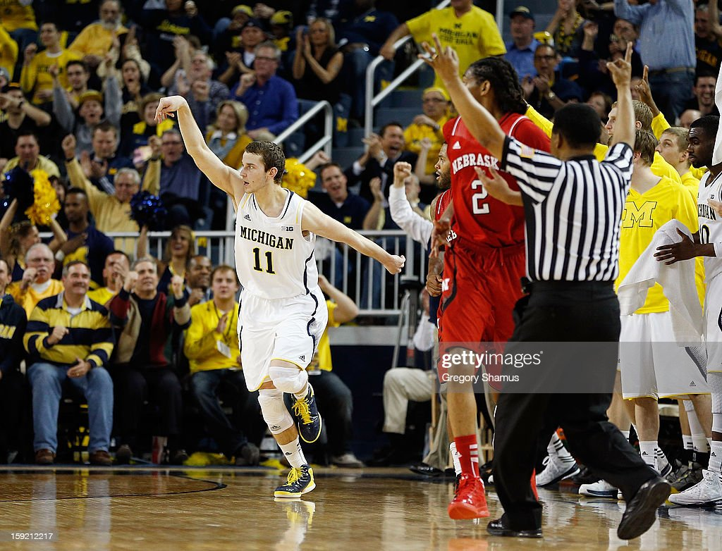 Nik Stauskas #11 of the Michigan Wolverines reacts after making a second half three point basket while playing the Nebraska Cornhuskers at Crisler Center on January 9, 2013 in Ann Arbor, Michigan. Michigan won the game 62-47.