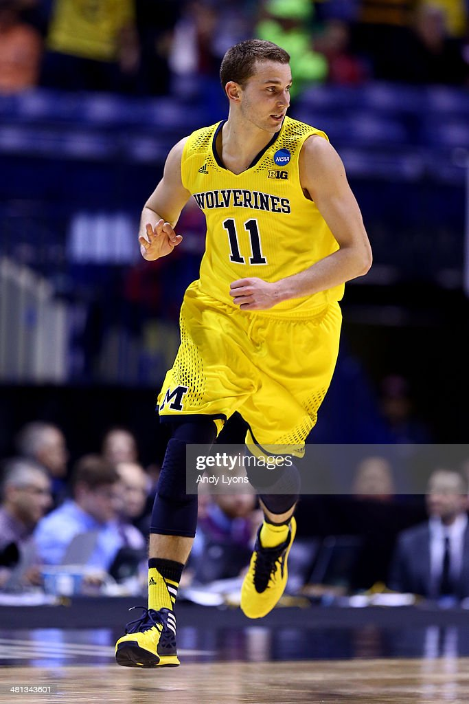 <a gi-track='captionPersonalityLinkClicked' href=/galleries/search?phrase=Nik+Stauskas&family=editorial&specificpeople=9920522 ng-click='$event.stopPropagation()'>Nik Stauskas</a> #11 of the Michigan Wolverines reacts against the Tennessee Volunteers during the regional semifinal of the 2014 NCAA Men's Basketball Tournament at Lucas Oil Stadium on March 28, 2014 in Indianapolis, Indiana.