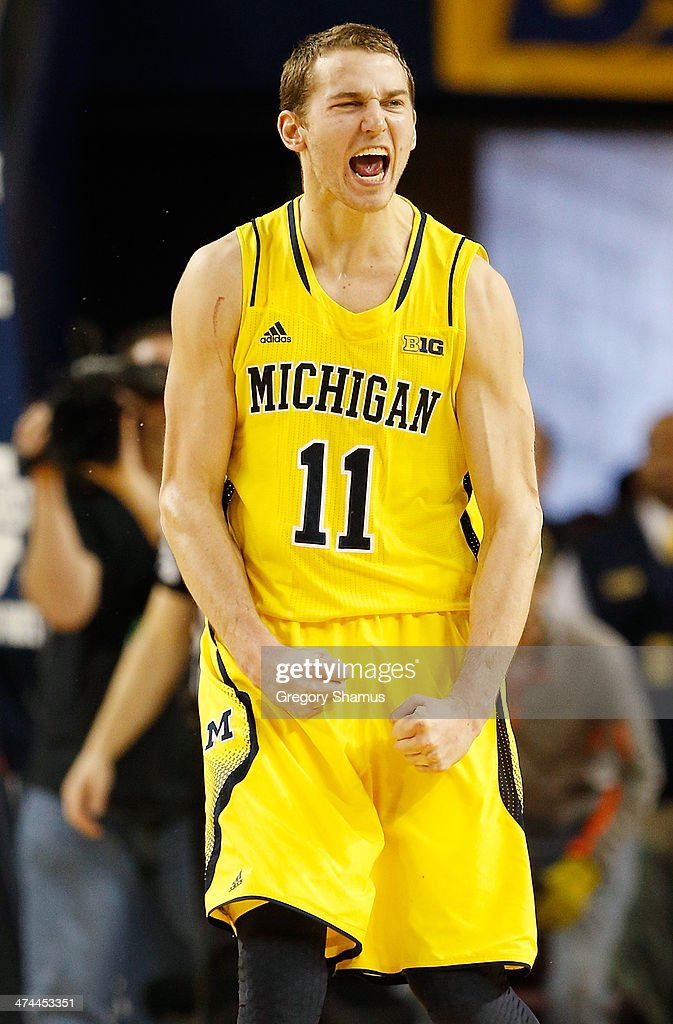 <a gi-track='captionPersonalityLinkClicked' href=/galleries/search?phrase=Nik+Stauskas&family=editorial&specificpeople=9920522 ng-click='$event.stopPropagation()'>Nik Stauskas</a> #11 of the Michigan Wolverines reacts during the second half while playing the Michigan State Spartans at Crisler Center on February 23, 2014 in Ann Arbor, Michigan. Michigan won the game 79-70.