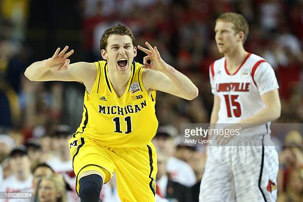 Nik Stauskas of the Michigan Wolverines reacts in the first half against Tim Henderson of the Louisville Cardinals during the 2013 NCAA Men's Final...