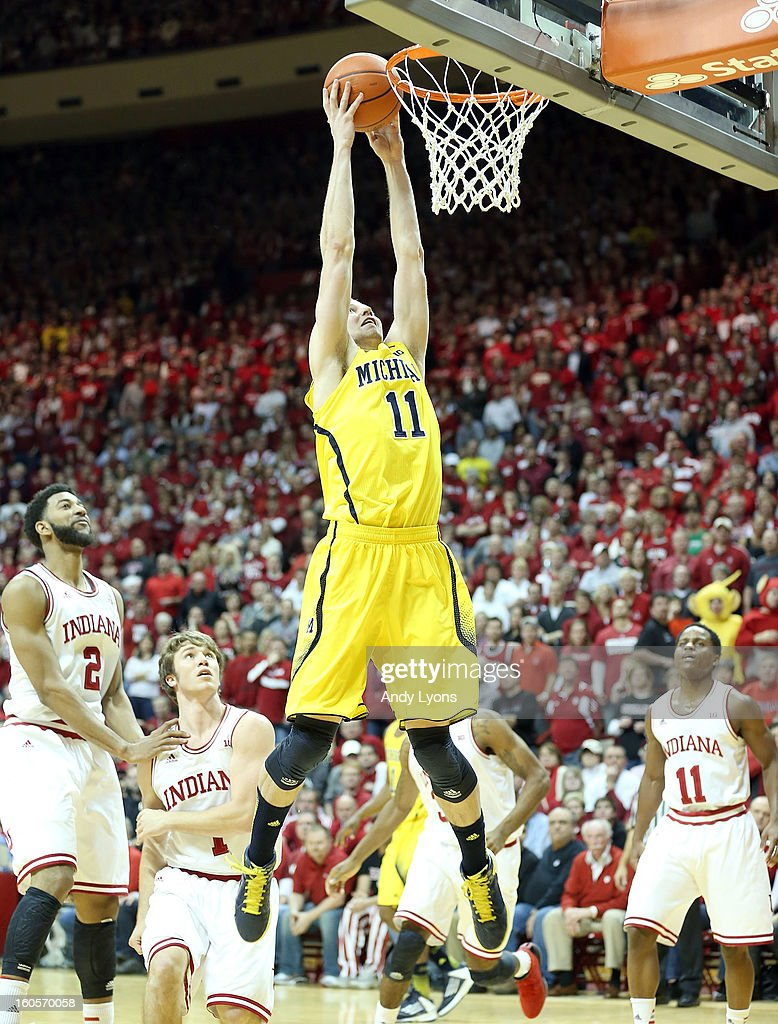 Nik Stauskas #11 of the Michigan Wolverines shoots the ball during the game against the Indiana Hoosiers at Assembly Hall on February 2, 2013 in Bloomington, Indiana.