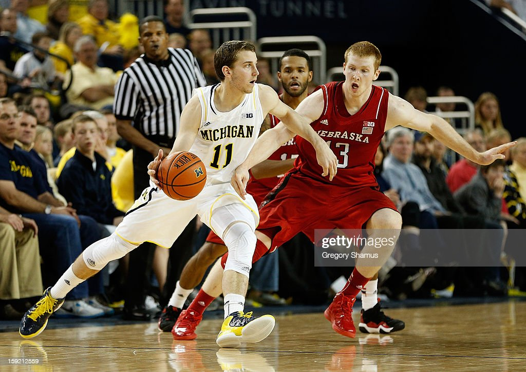 Nik Stauskas #11 of the Michigan Wolverines tries to get around the defense of Brandon Ubel #13 of the Nebraska Cornhuskers during the second half at Crisler Center on January 9, 2013 in Ann Arbor, Michigan. Michigan won the game 62-47.