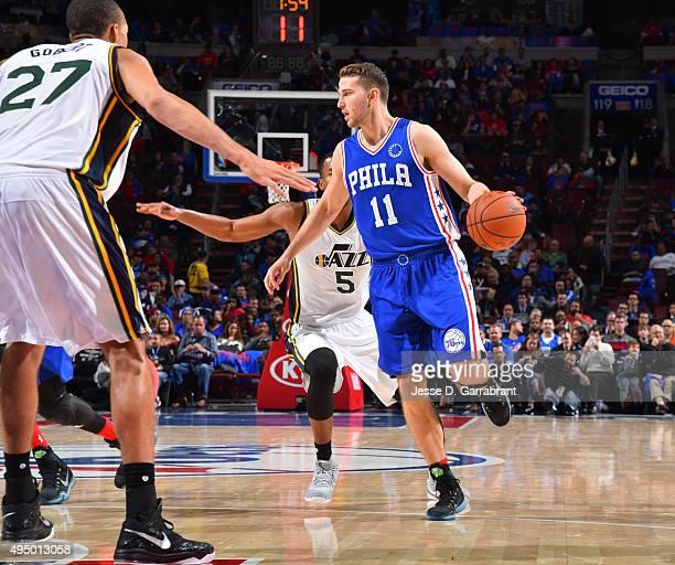 Nik Stauskas of the Philadelphia 76ers dribble up the court against the Utah Jazz at Wells Fargo Center on October 30 2015 in Philadelphia...