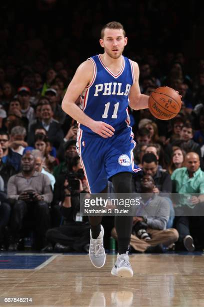 Nik Stauskas of the Philadelphia 76ers handles the ball against the New York Knicks on April 12 2017 at Madison Square Garden in New York City New...