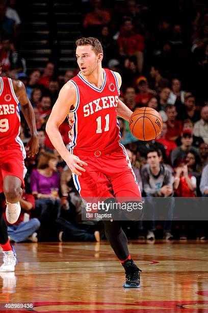 Nik Stauskas of the Philadelphia 76ers handles the ball during the game against the Houston Rockets on November 27 2015 at the Toyota Center in...