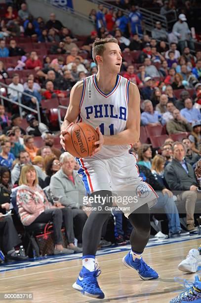 Nik Stauskas of the Philadelphia 76ers looks to pass the ball against the Denver Nuggets at Wells Fargo Center on December 5 2015 in Philadelphia...