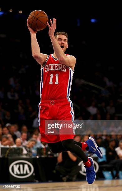 Nik Stauskas of the Philadelphia 76ers passes the ball in the first half against the New York Knicks at Madison Square Garden on December 2 2015 in...