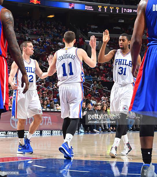 Nik Stauskas of the Philadelphia 76ers shakes hands with his team mates against the Detroit Pistons at Wells Fargo Center on March 12 2016 in...