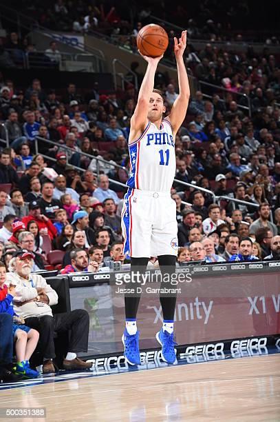 Nik Stauskas of the Philadelphia 76ers shoots a three pointer against the San Antonio Spurs at Wells Fargo Center on December 7 2015 in Philadelphia...