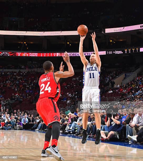 Nik Stauskas of the Philadelphia 76ers shoots the ball against the Toronto Raptors at Wells Fargo Center on November 11 2015 in Philadelphia...