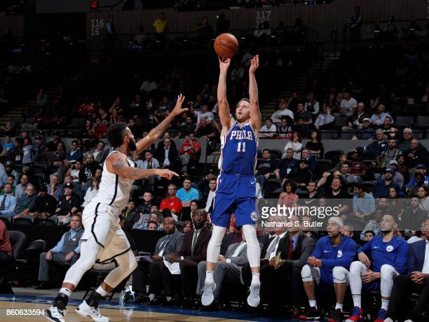 Nik Stauskas of the Philadelphia 76ers shoots the ball against the Brooklyn Nets on October 11 2017 at Nassau Veterans Memorial Coliseum in Uniondale...