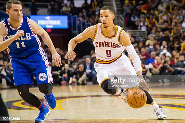 Nik Stauskas of the Philadelphia 76ers tries to guard Jared Cunningham of the Cleveland Cavaliers during the second half at Quicken Loans Arena on...