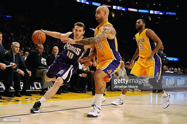 Nik Stauskas of the Sacramento Kings drives the ball past Robert Sacre of the Los Angeles Lakers during a game at Staples Center on December 9 2014...