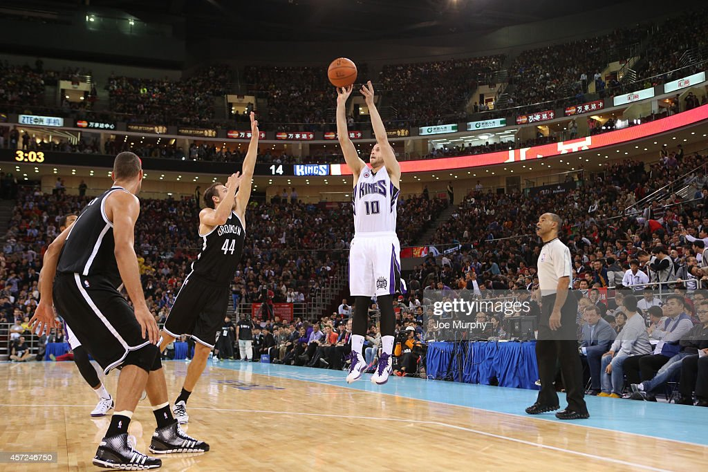 <a gi-track='captionPersonalityLinkClicked' href=/galleries/search?phrase=Nik+Stauskas&family=editorial&specificpeople=9920522 ng-click='$event.stopPropagation()'>Nik Stauskas</a> #10 of the Sacramento Kings shoots a jump shot against the Brooklyn Nets during the 2014 NBA Global Games at the MasterCard Center on October 15, 2014 in Beijing, China.