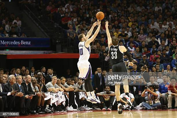 Nik Stauskas of the Sacramento Kings shoots against Mirza Teletovic of the Brooklyn Nets during the 2014 NBA Global Games at the MercedesBenz Arena...