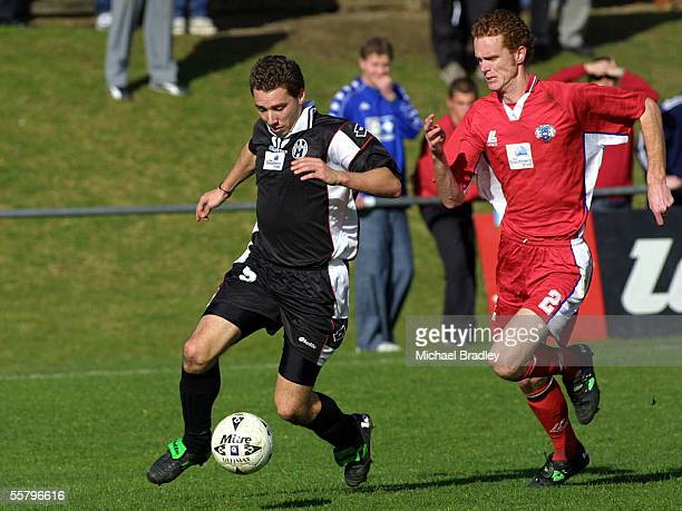 Nik Viljoen from Waitakere City gets ahead of James Patterson from Uni Mount Wellington during their clash in the Southern Trust National Soccer...