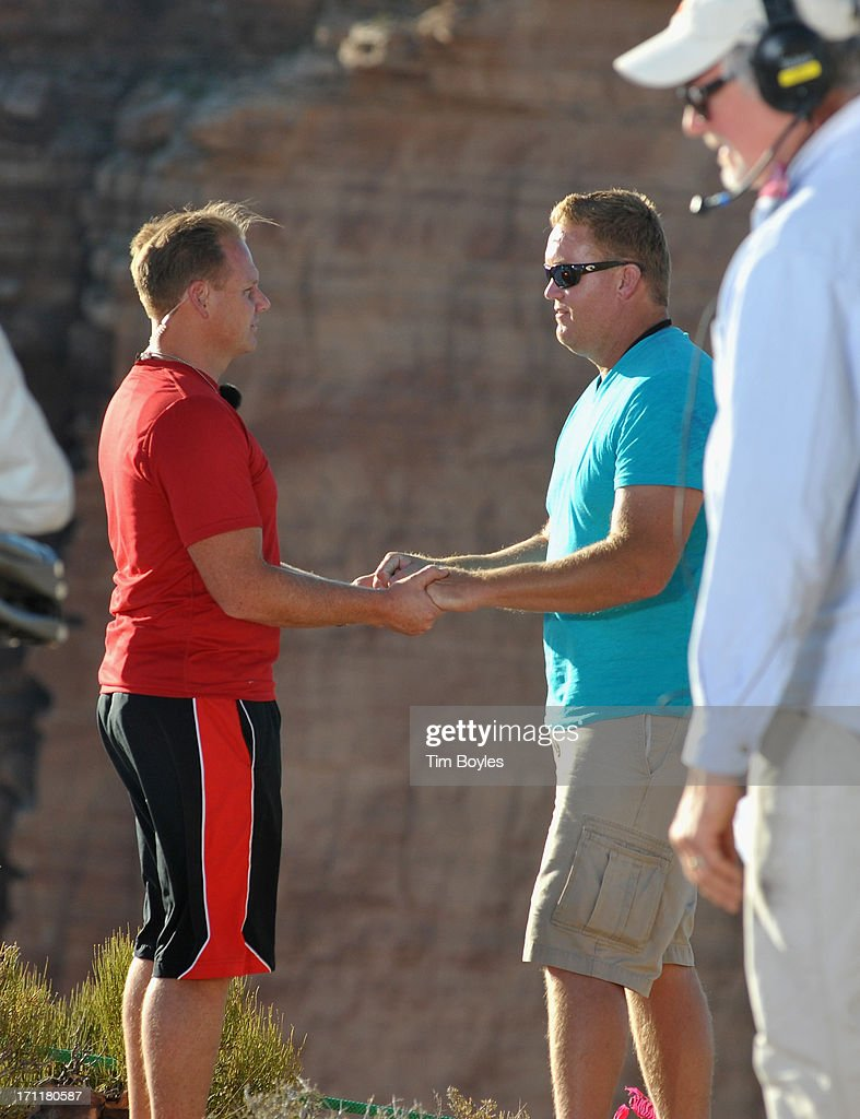 <a gi-track='captionPersonalityLinkClicked' href=/galleries/search?phrase=Nik+Wallenda&family=editorial&specificpeople=7696638 ng-click='$event.stopPropagation()'>Nik Wallenda</a> (L) and Mike Duff (R) rehearse Wallenda's greeting for his wife for television cameras after finishing a training session before his historic high wire walk over the Grand Canyon at The Grand Canyon on June 22, 2013 in Grand Canyon, Arizona.