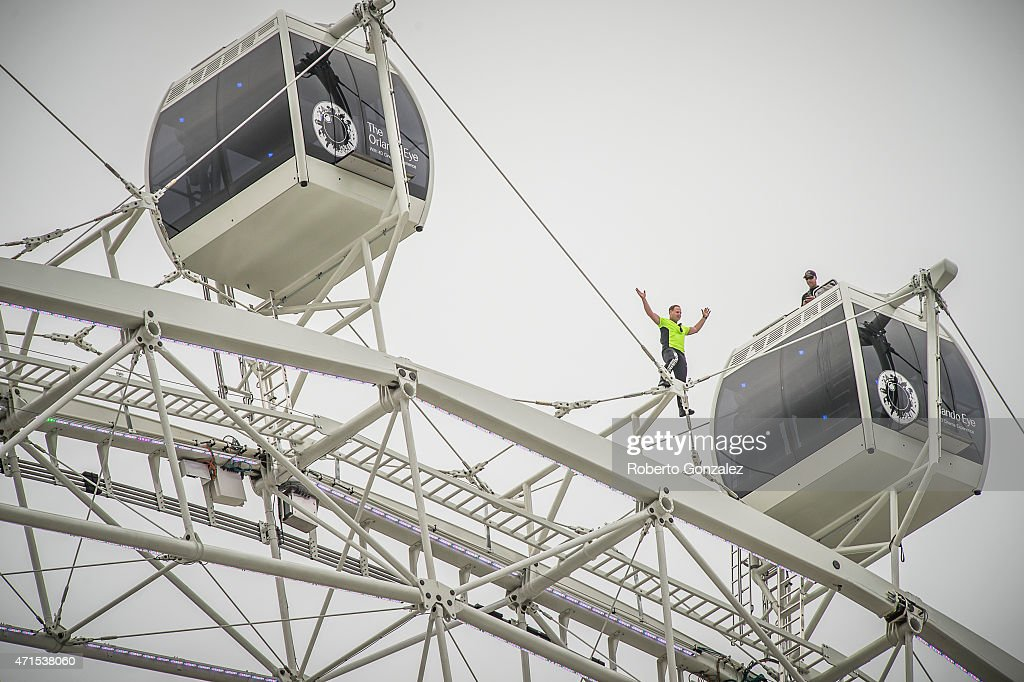 <a gi-track='captionPersonalityLinkClicked' href=/galleries/search?phrase=Nik+Wallenda&family=editorial&specificpeople=7696638 ng-click='$event.stopPropagation()'>Nik Wallenda</a> balances atop the Orlando Eye, I-Drive 360-home of the new Orlando Eye-celebrated its grand opening with a record-breaking walk by 'King of the High Wire' <a gi-track='captionPersonalityLinkClicked' href=/galleries/search?phrase=Nik+Wallenda&family=editorial&specificpeople=7696638 ng-click='$event.stopPropagation()'>Nik Wallenda</a> on April 29, 2015 in Orlando, Florida. On Wednesday morning, Nik walked atop the 400-foot observation wheel-the tallest on the East Coast of the United States-while it was in motion and without a safety harness or balancing pole.