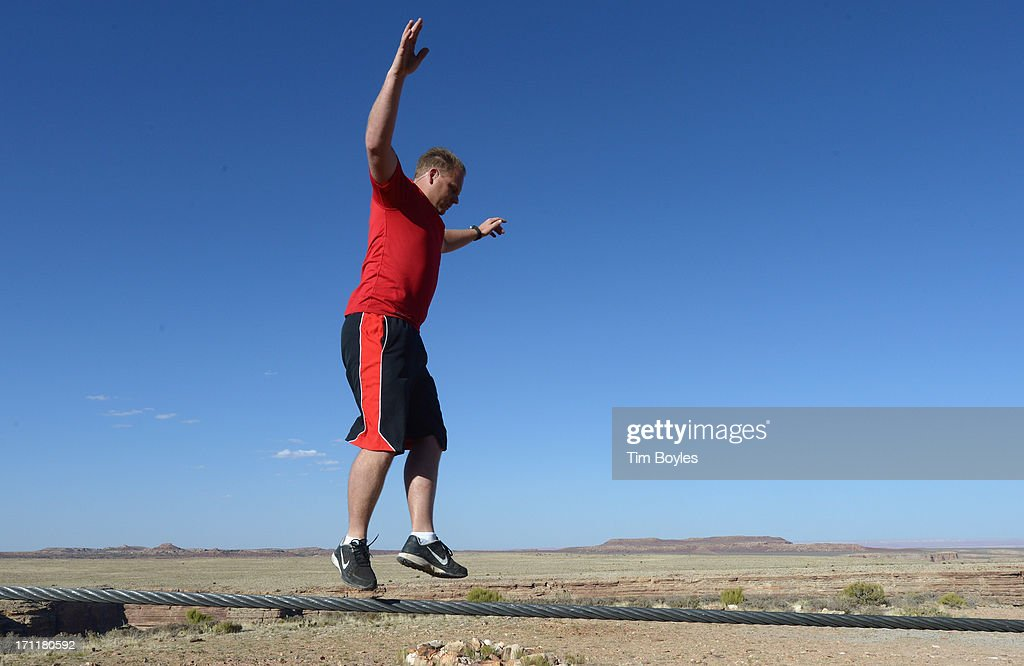 <a gi-track='captionPersonalityLinkClicked' href=/galleries/search?phrase=Nik+Wallenda&family=editorial&specificpeople=7696638 ng-click='$event.stopPropagation()'>Nik Wallenda</a> jumps during a training session before his historic high wire walk over the Grand Canyon at The Grand Canyon on June 22, 2013 in Grand Canyon, Arizona.