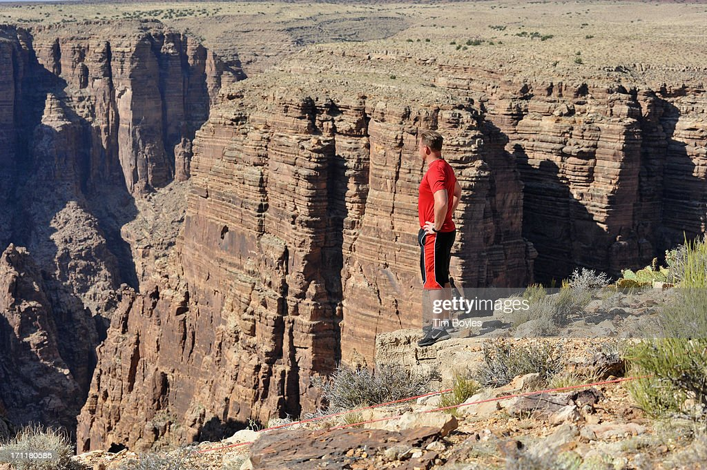 <a gi-track='captionPersonalityLinkClicked' href=/galleries/search?phrase=Nik+Wallenda&family=editorial&specificpeople=7696638 ng-click='$event.stopPropagation()'>Nik Wallenda</a> looks over the Grand Canyon during a training session before his historic high wire walk over the Grand Canyon at The Grand Canyon on June 22, 2013 in Grand Canyon, Arizona.
