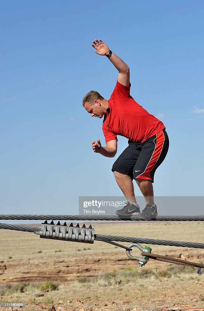 <a gi-track='captionPersonalityLinkClicked' href=/galleries/search?phrase=Nik+Wallenda&family=editorial&specificpeople=7696638 ng-click='$event.stopPropagation()'>Nik Wallenda</a> practices during a training session before his historic high wire walk over the Grand Canyon at The Grand Canyon on June 22, 2013 in Grand Canyon, Arizona.