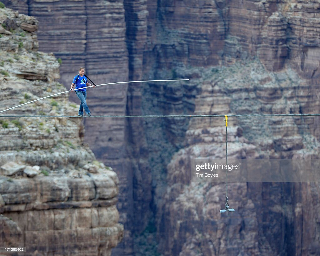 <a gi-track='captionPersonalityLinkClicked' href=/galleries/search?phrase=Nik+Wallenda&family=editorial&specificpeople=7696638 ng-click='$event.stopPropagation()'>Nik Wallenda</a> walks a high wire over the Grand Canyon at The Grand Canyon on June 23, 2013 in Grand Canyon, Arizona.