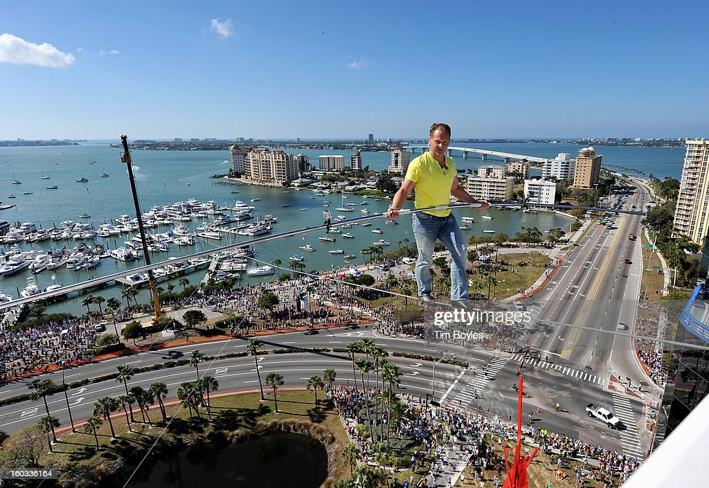 Nik Wallenda walks across a tightrope 200 feet above U.S. 41 on January 29, 2013 in Sarasota, Florida.