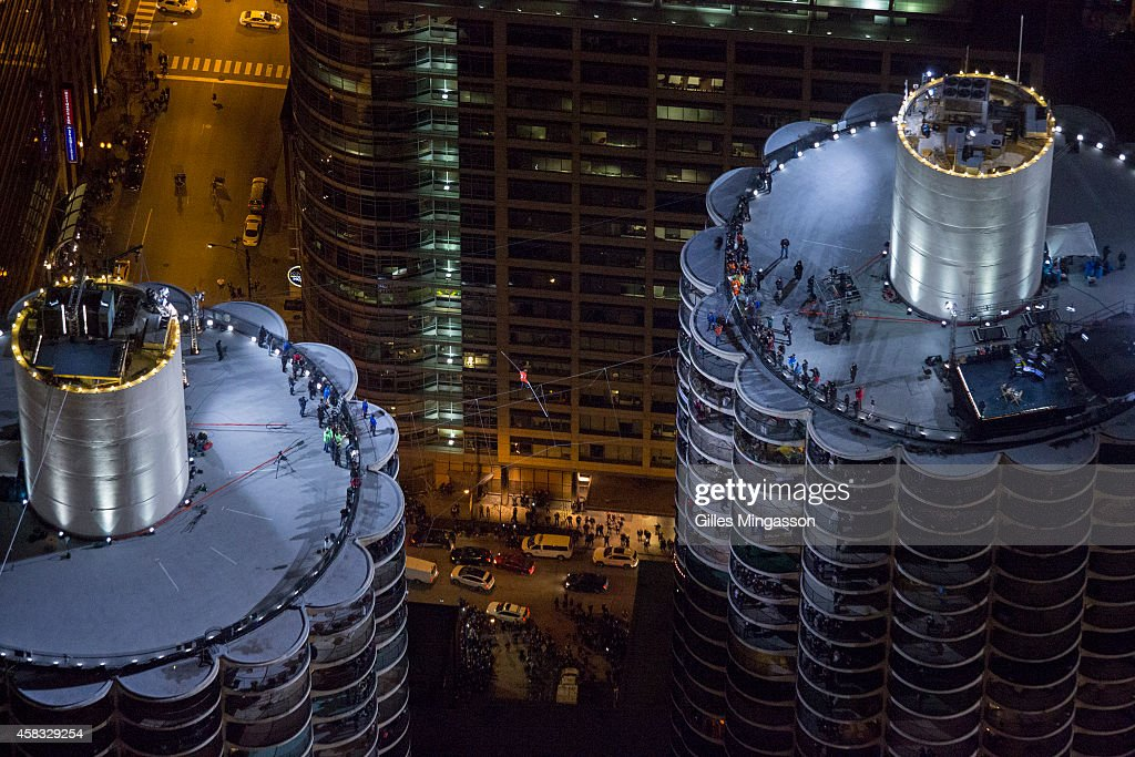 <a gi-track='captionPersonalityLinkClicked' href=/galleries/search?phrase=Nik+Wallenda&family=editorial&specificpeople=7696638 ng-click='$event.stopPropagation()'>Nik Wallenda</a> walks over the Chicago skyline blindfolded 600 feet above the ground for Discovery Channel's Skyscraper Live with <a gi-track='captionPersonalityLinkClicked' href=/galleries/search?phrase=Nik+Wallenda&family=editorial&specificpeople=7696638 ng-click='$event.stopPropagation()'>Nik Wallenda</a> on November 2, 2014 in Chicago, Illinois. (Photo Gilles Mingasson/Getty Images for Discovery Channel).