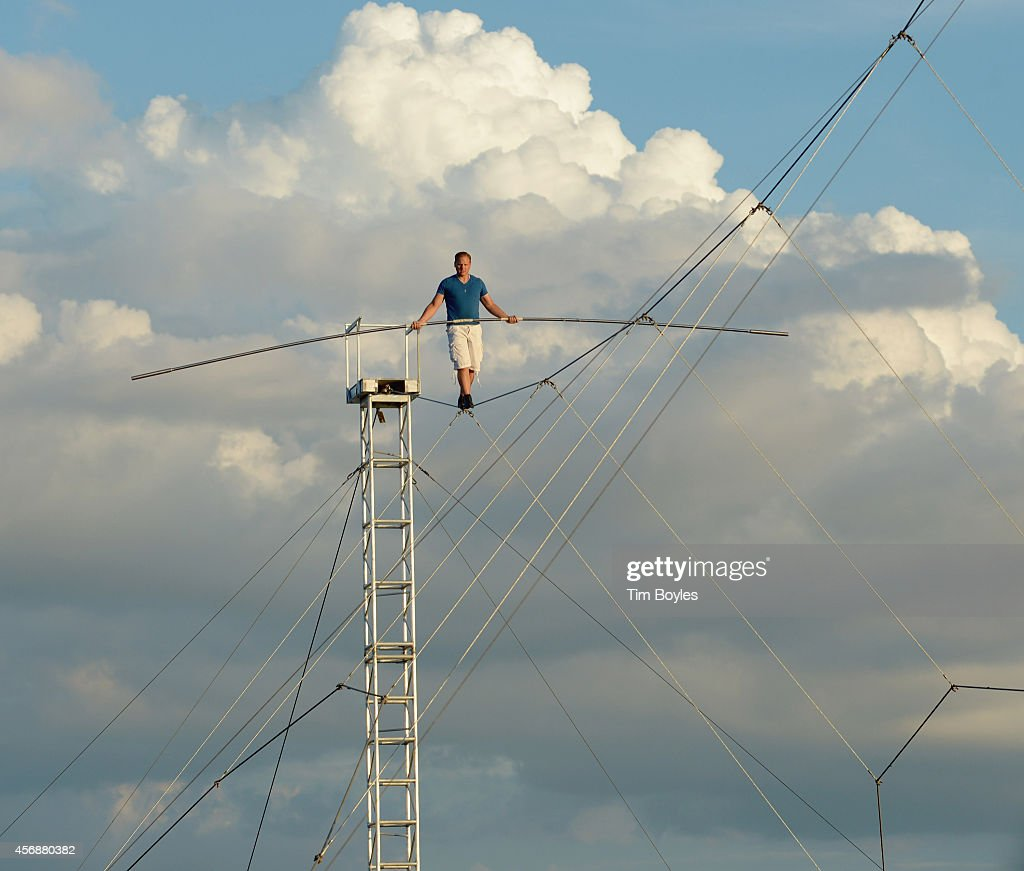 <a gi-track='captionPersonalityLinkClicked' href=/galleries/search?phrase=Nik+Wallenda&family=editorial&specificpeople=7696638 ng-click='$event.stopPropagation()'>Nik Wallenda</a> walks up a high wire at a 15-degree angle while training for his upcoming walk across the Chicago skyline on October 8, 2014 in Sarasota, Florida. <a gi-track='captionPersonalityLinkClicked' href=/galleries/search?phrase=Nik+Wallenda&family=editorial&specificpeople=7696638 ng-click='$event.stopPropagation()'>Nik Wallenda</a>'s walk across the Chicago skyline on November 2nd will be broadcast live by the Discovery Channel.