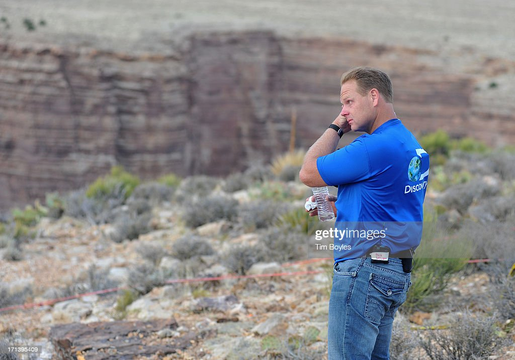 <a gi-track='captionPersonalityLinkClicked' href=/galleries/search?phrase=Nik+Wallenda&family=editorial&specificpeople=7696638 ng-click='$event.stopPropagation()'>Nik Wallenda</a> wipes his face following his historic walk at The Grand Canyon on June 23, 2013 in Grand Canyon, Arizona.
