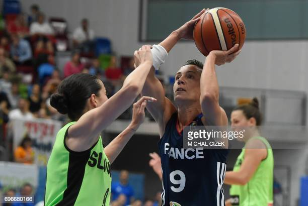 Nika Baric of Slovenia tries to block a shot by Celine Dumerc of France during the FIBA EuroBasket women's basketball match Slovania v France on June...