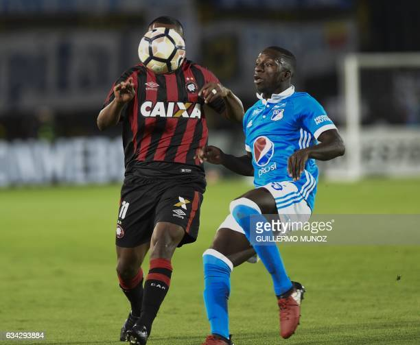 Nikao from Brazil's Atletico Paranaense vies for the ball with Deiver Machado from Colombia's Millonarios during a Libertadores Cup football match at...